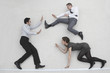 three business people fighting, elevated view
