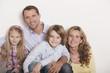 Deutschland, Familie sitzen auf Treppe, lachen, Portrait, close-up