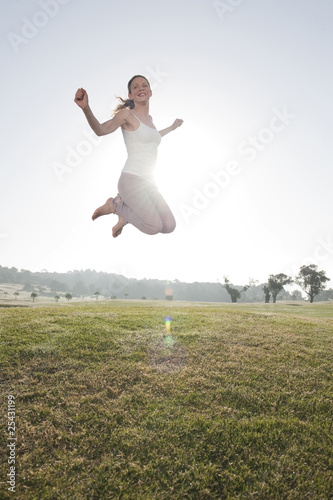 spain, mallorca, woman jumping for joy