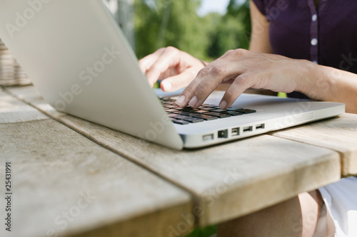 germany, hamburg, woman's hand typing on laptop