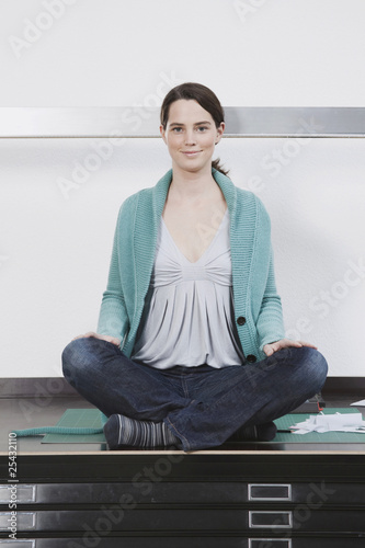 woman relaxing on table, smiling