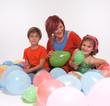 Mom and kids in a balloon party