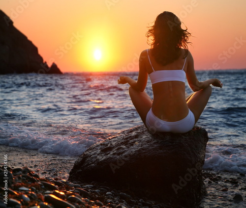 Meditation on the beach at sunset.