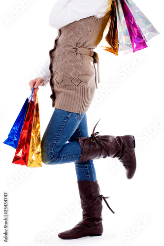 lady standing with shopping bags