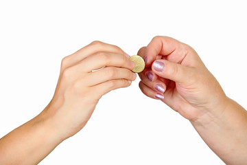Female hand giving coin to another person