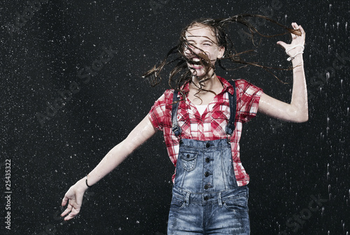 girl jumping in rain, laughing.