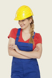 young woman wearing hard hat, smiling, close-up