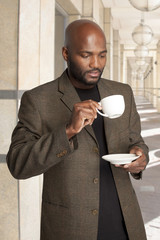 South African businessman having a coffee.
