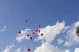 germany, bavaria, red balloons flying against sky