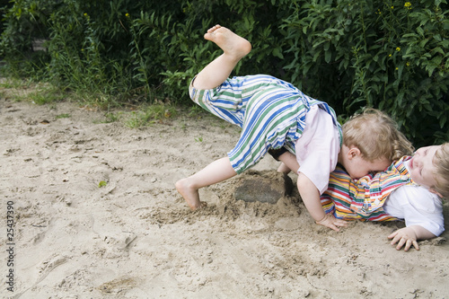 germany, berlin, two boys (2-3) (3-4) playing together in sandbox