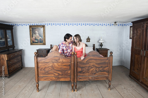 germany, bavaria, young couple in rural bedroom