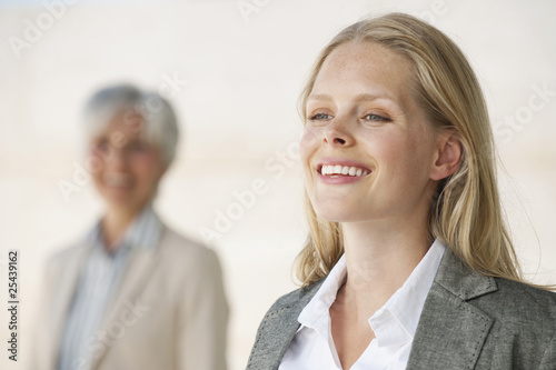 two businesswomen, smiling, portrait
