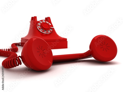 red telephone with headphone in front