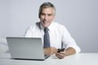 happy senior businessman laptop mobile portrait