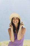 italy, south tyrol, woman wearing hat, laughing, portrait