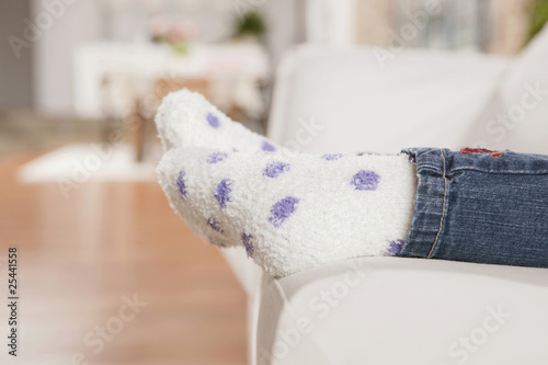 germany, cologne, close-up of child's legs wearing socks, low section