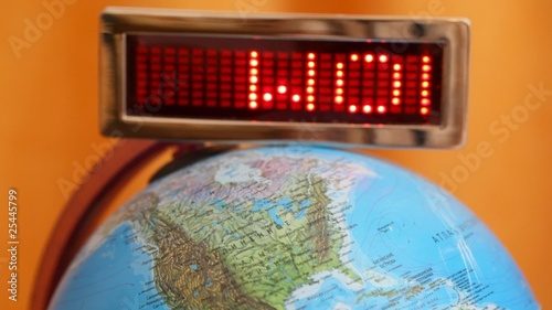 LED display withword world is on globe on an orange