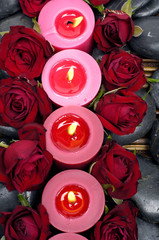 Top view row of candles with red rose petals