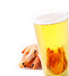 glass of beer with shrimps reflected isolated