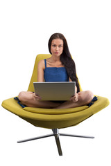 Young female sitting in the fashionable chair with laptop