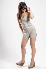 joyful teenager girl showing accessories in studio