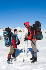 Hiker are in winter mountains