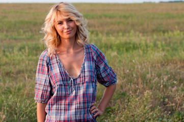 Beautiful blond young woman in a countryside