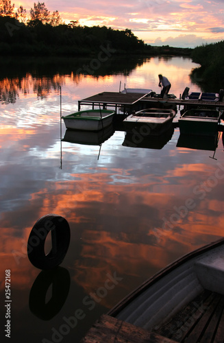 Foto op Plexiglas Bruin Bay of boats at beautiful colorful sundown