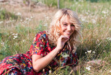 Beautiful blond woman with wild flowers
