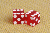 Casino dice on golden fabric
