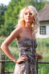 Beautiful blond young woman in the village