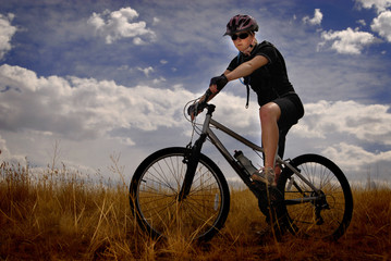 Young Woman Mountain Biking