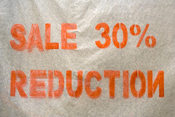 Sale reduction sign