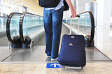 Traveler with a bag at the speedwalk poster