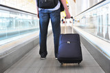 Traveler with a bag on the speedwalk poster