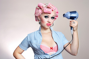 Unhappy housewife with hairdryer