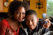 African-American woman with young man in kitchen