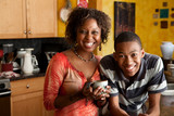 African-American woman and young man in kitchen