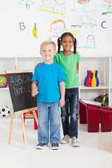 happy preschool kids in classroom