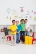 happy kindergarten classmates in classroom