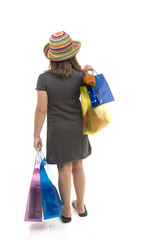 young girl with shopping bags from behind
