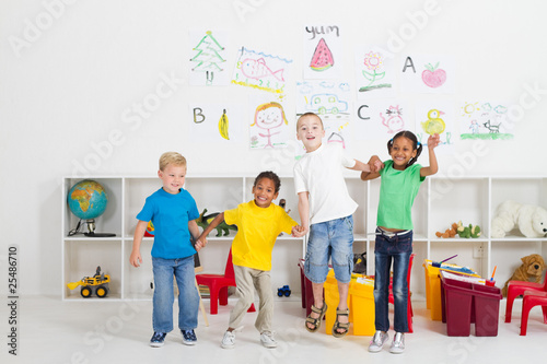 preschool kids jumping in classroom