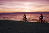 Bicyclists on the beach poster