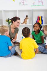 preschool teacher reading children books