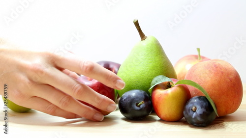 woman selects fruit.