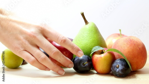 woman selects fruit