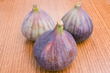 Three delicious fresh ripe figs close-up