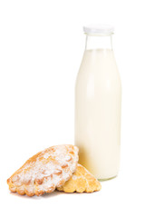 milk bottle with cakes isolated on the white background