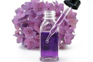 duftölflasche mit blume