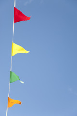 Colorful Flags against a Blue Sky Background